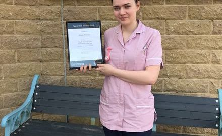 Hospice apprentice praised at college awards