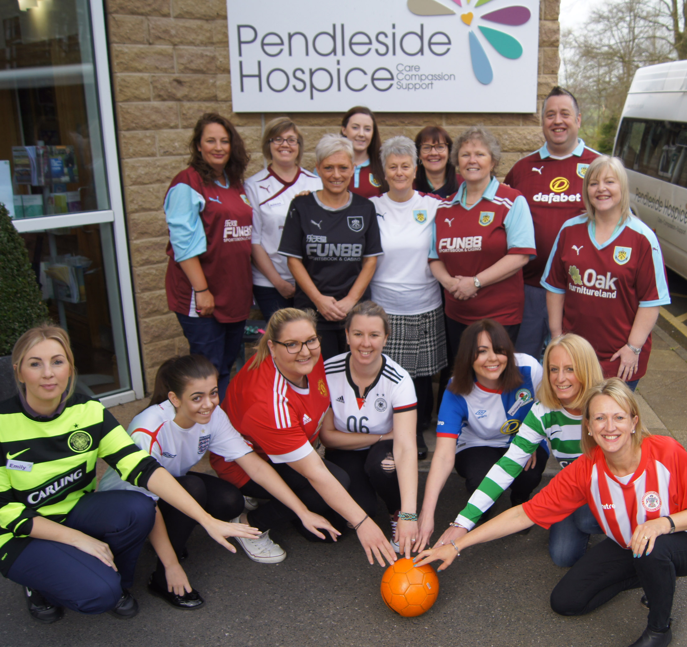 Wear your Shirt to Work day at Pendleside staff & volunteer photo with football